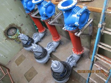 Disc filter pump station including spare/redundant pump and new piping.